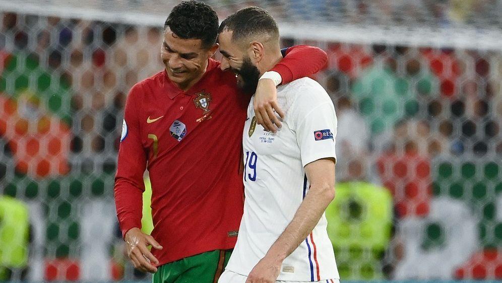 Benzema und Ronaldo gratulieren sich zu EM-Doppelpacks - Bildquelle: AFPPOOLSIDFRANCK FIFE