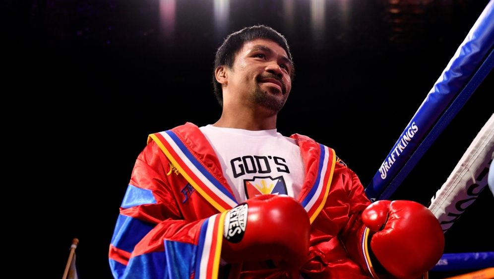 Manny Pacquiao hängt Box-Handschuhe an den Nagel - Bildquelle: AFPSIDPatrick T. FALLON