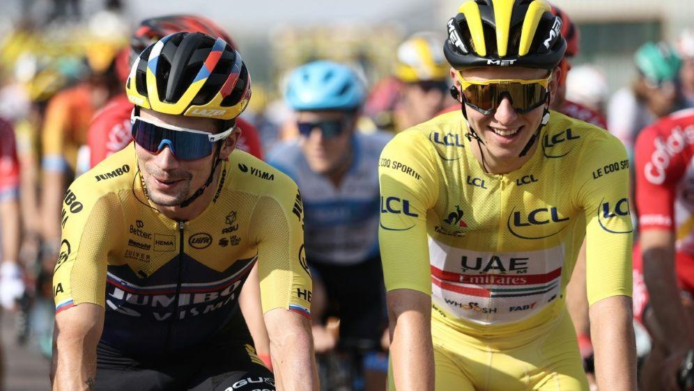 Radsport: Roglic (l.) und Pogacar sind Favoriten - Bildquelle: AFPSIDKENZO TRIBOUILLARD