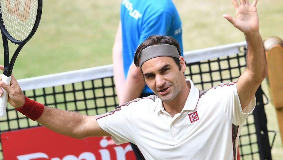 Roger Federer besiegt David Goffin im Finale in Halle - Bildquelle: AFPSIDCARMEN JASPERSEN