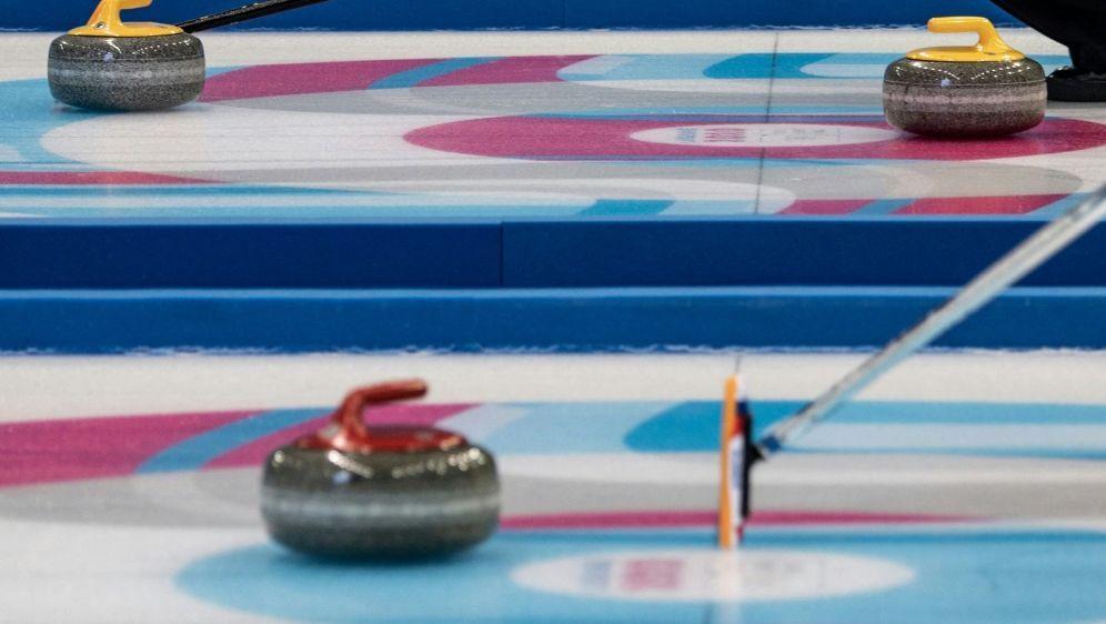 Deutschlands Curler bekommen ihre erste Niederlage - Bildquelle: AFPSIDJEFF PACHOUD