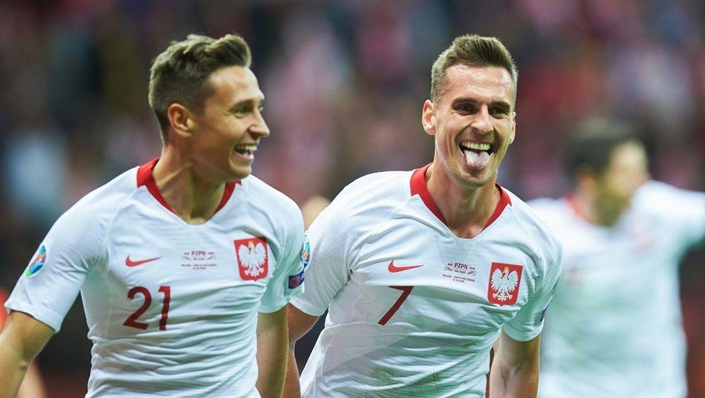 Milik (r.) bejubelt seinen Treffer zum 2:0-Endstand - Bildquelle: AFPSIDLUKASZ SZELAG