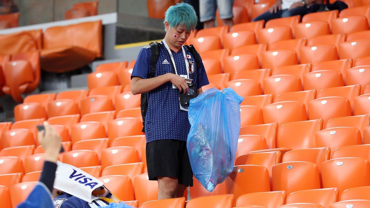 Japaner machen sauber - Bildquelle: 2018 Getty Images