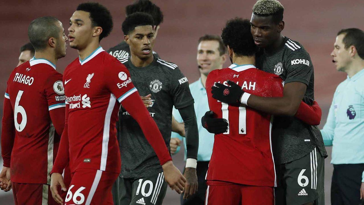 Manchester United und FC Liverpool ernten Kritik wegen Trikots - Bildquelle: imago