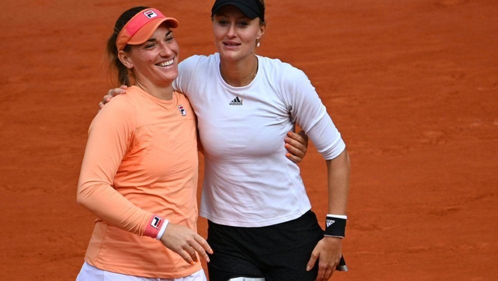 Mladenovic und Babos (l.) gewinnen erneut in Paris - Bildquelle: AFPSIDAnne-Christine POUJOULAT