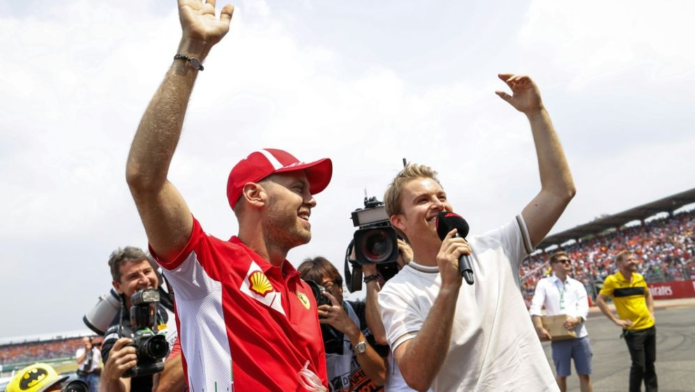 Rosberg (r.) glaubt an Comeback von Vettel - Bildquelle: PIXATHLOPIXATHLOSID