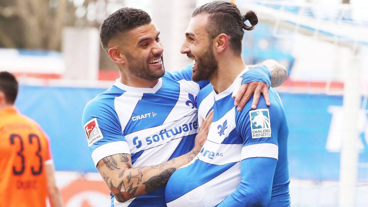 Victor Palsson und Serdar Dursun (beide SV Darmstadt) - Bildquelle: imago images/Picture Point