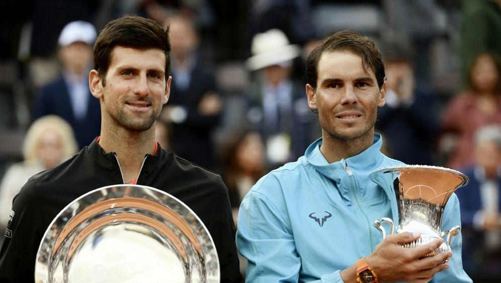 Djokovic (l.) und Nadal werden beim ATP Cup antreten - Bildquelle: AFPSIDFILIPPO MONTEFORTE