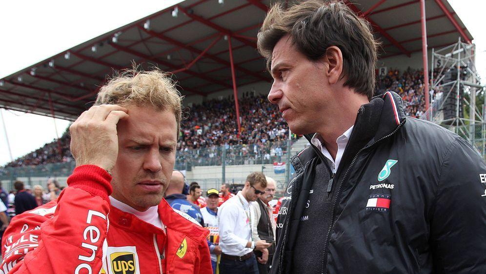 Sebastian Vettel und Toto Wolff. - Bildquelle: imago/LaPresse