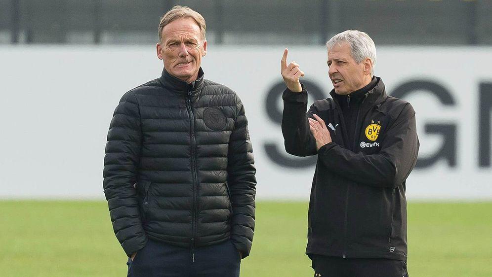 Schwere Zeiten in Dortmund: Geschäftsführer Hans-Joachim Watzke (l.) und Tra... - Bildquelle: imago