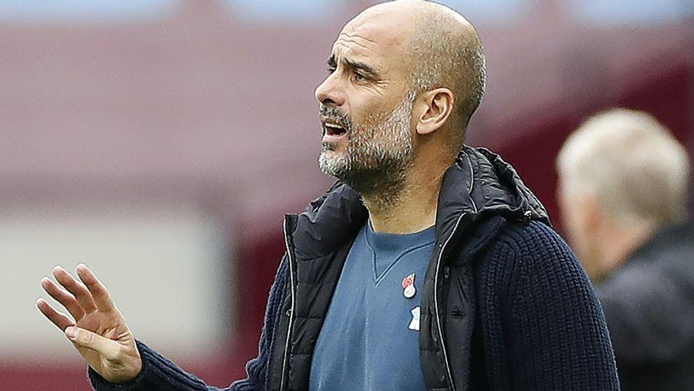 Guardiola sieht seine Zukunft weiter bei ManCity - Bildquelle: AFPSIDPAUL CHILDS