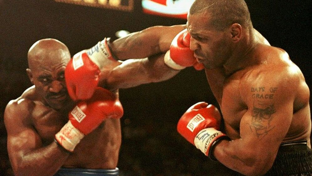 Holyfield und Tyson möchten für den guten Zweck kämpfen - Bildquelle: AFPSIDJEFF HAYNES