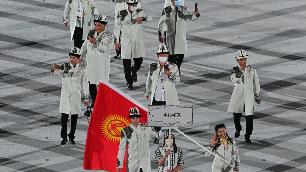 Athleten aus Kirgisistan missachten Hygienemaßnahmen - Bildquelle: AFPSIDMARTIN BUREAU