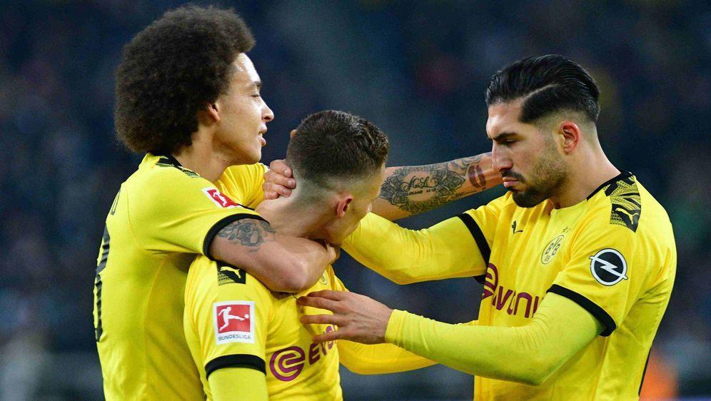 Könnte gegen Wolfsburg sein Comeback feiern: Emre Can (r.). - Bildquelle: imago