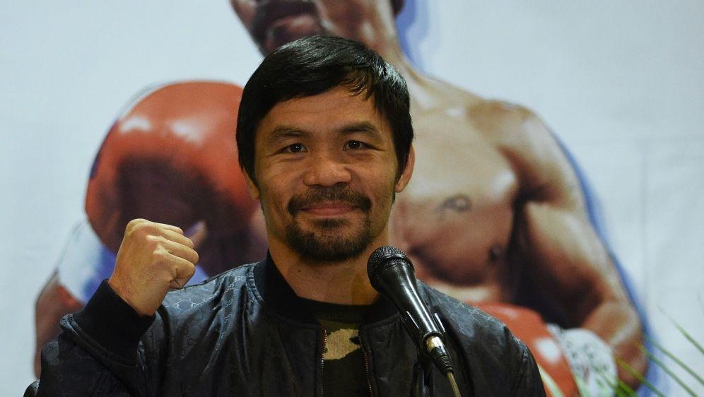 Pacquiao hat seinem Sohn erlaubt, ebenfalls zu boxen - Bildquelle: AFPSIDTED ALJIBE