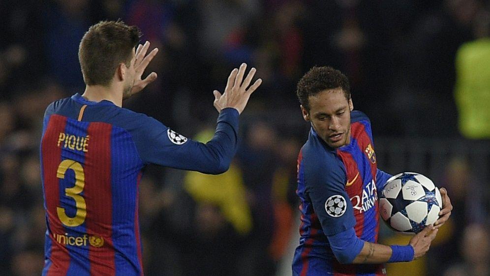 Pique (l.) wollte Neymar (r.) zurück zu Barca locken - Bildquelle: AFPSIDLLUIS GENE