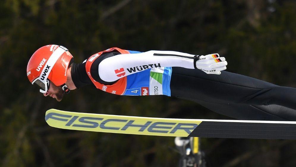 Eisenbichler springt auf Platz vier - Bildquelle: AFPSIDJOE KLAMAR