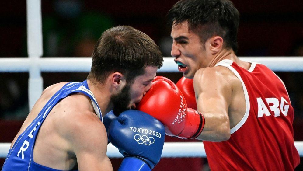 Hamsat Shadalov (l) verliert gegen Mirco Jehiel - Bildquelle: AFPSIDLUIS ROBAYO