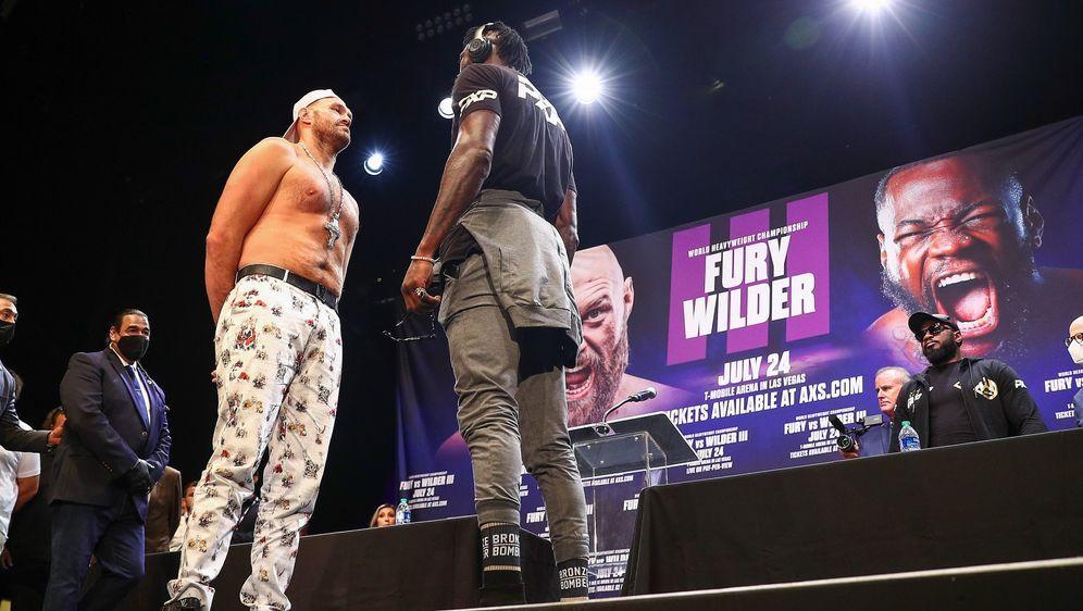Tyson Fury (l.) und Deontay Wilder wollen am 24. Juli gegeneinander kämpfen. - Bildquelle: Getty