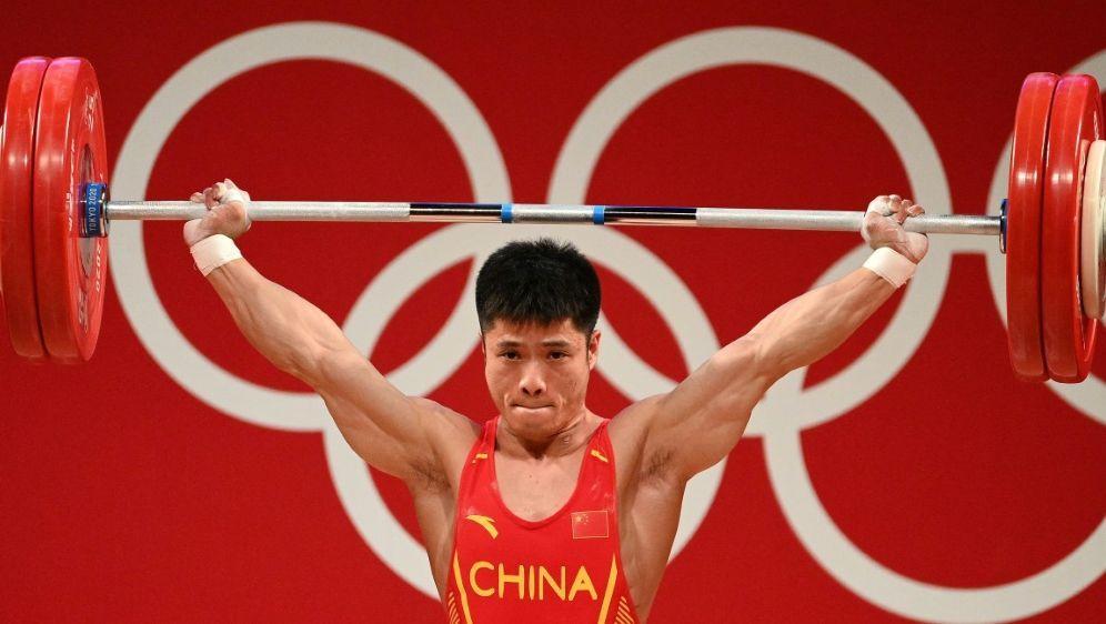 Gewichtheber Li Fabin gewinnt Gold für China - Bildquelle: AFPSIDVINCENZO PINTO