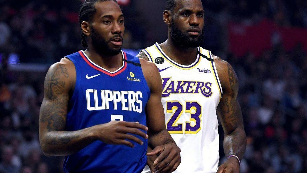 Lakers gegen Clippers mit LeBron James (r.) zum Auftakt - Bildquelle: AFPGETTY IMAGES SIDHarry How
