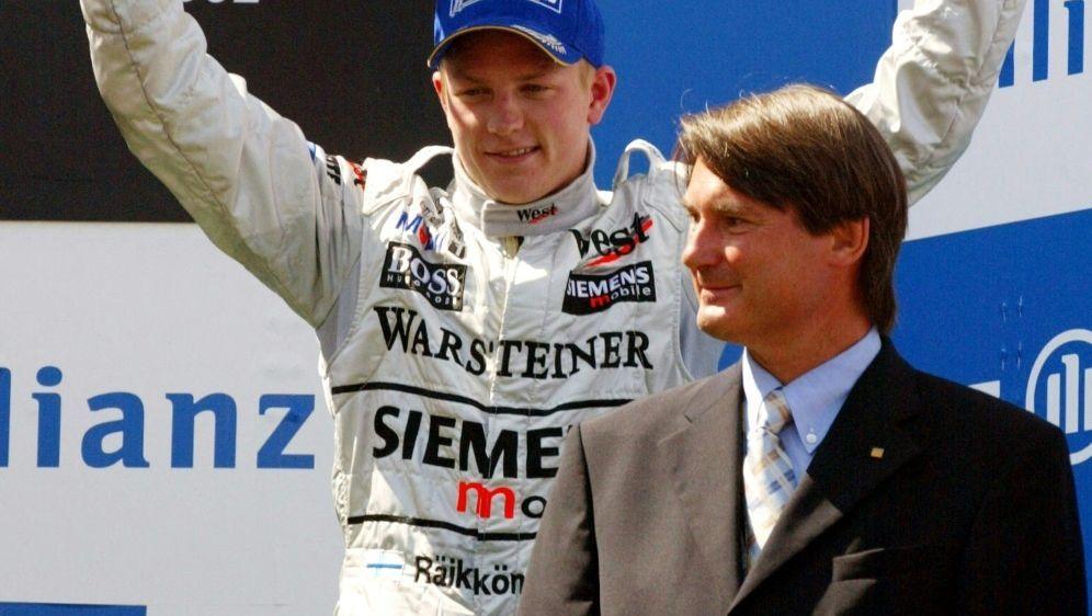 Hermann Tomczyk (r.) neben Kimi Raikkönen - Bildquelle: AFPSIDPIERRE VERDY