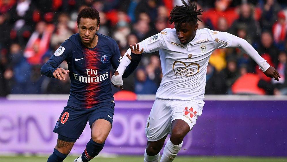 Neymar (links) sicherte PSG per Elfmeter einen Punkt - Bildquelle: AFPSIDANNE-CHRISTINE POUJOULAT