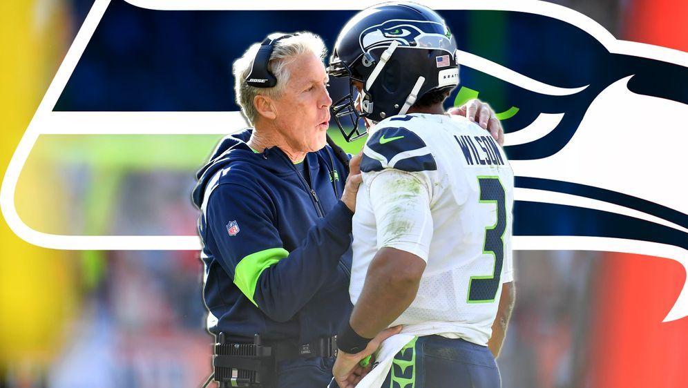 Im Gespräch mit seinem Head Coach Pete Carroll: Russell Wilson - Bildquelle: Getty Images