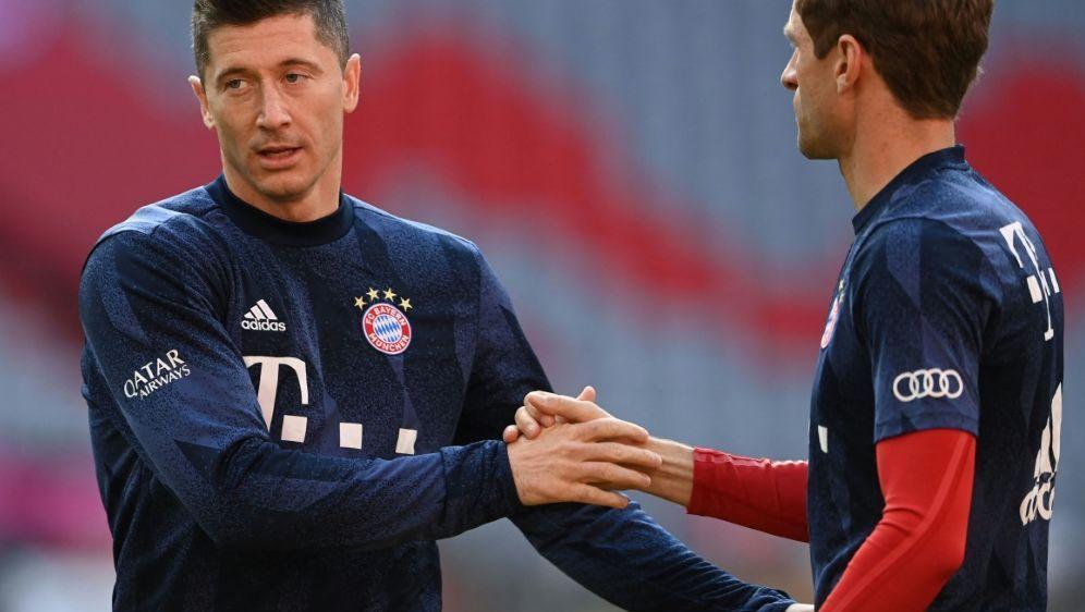 Meister schon vor Spielbeginn: Lewandowski und Müller - Bildquelle: AFPPOOLSIDCHRISTOF STACHE