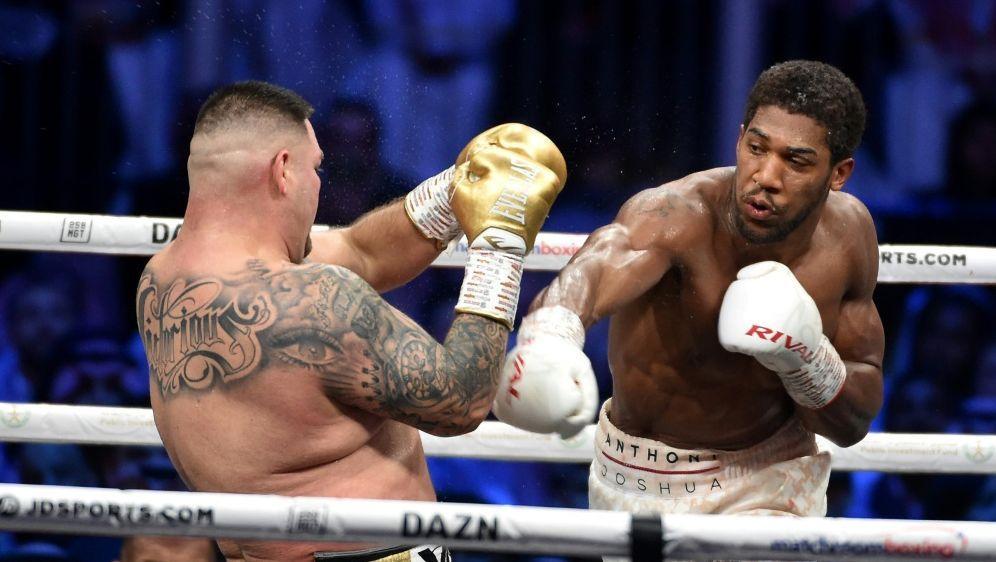 Weltmeister Joshua will auch den WBC-Gürtel gewinnen - Bildquelle: AFPSIDFayez Nureldine