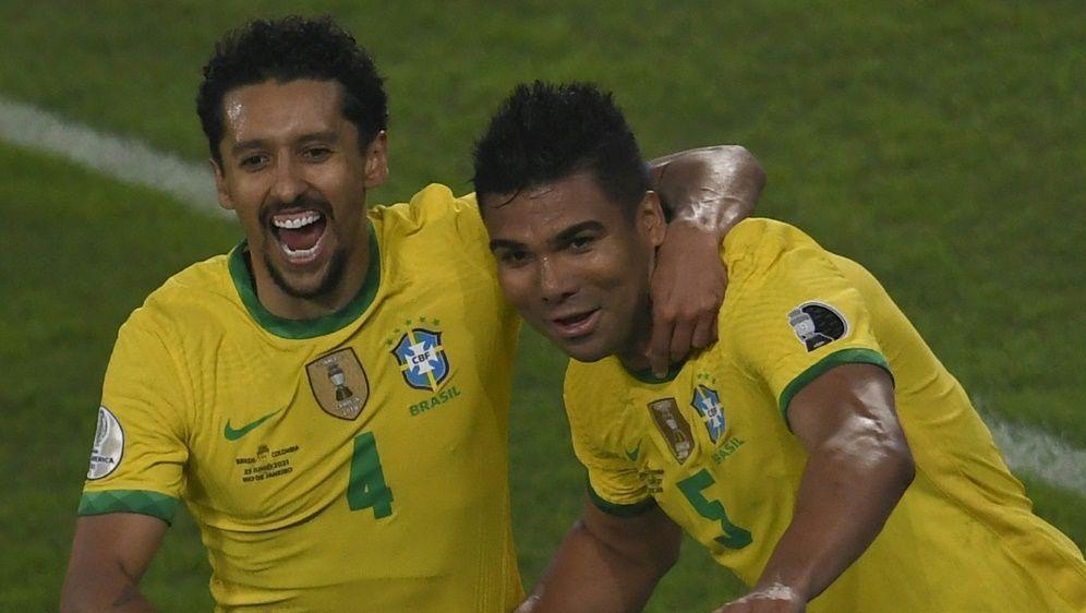 Casemiro (r.) bejubelt seinen Siegtreffer für Brasilien - Bildquelle: AFPSIDMAURO PIMENTEL