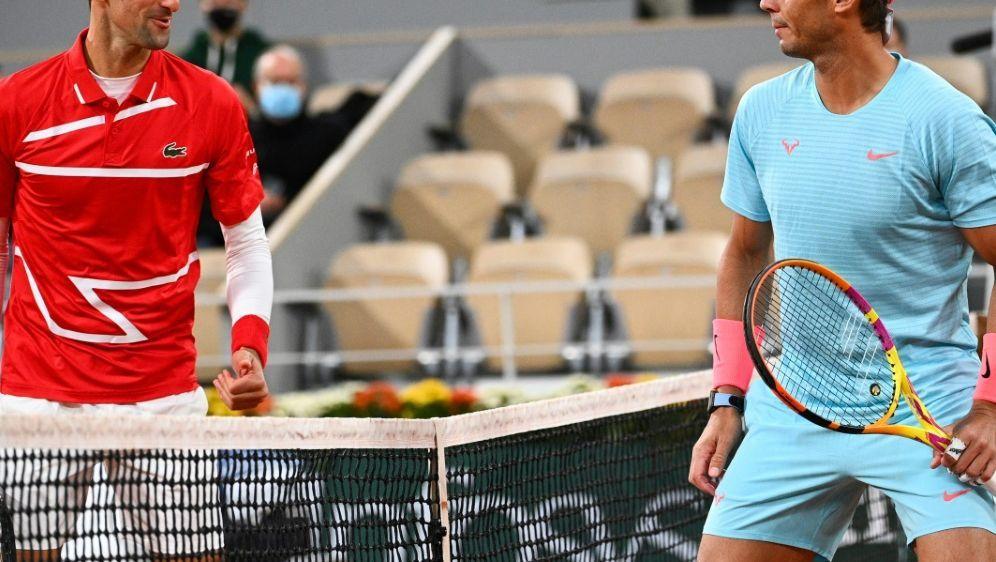 Rafael Nadal und Novak Djokovic duellieren sich oft - Bildquelle: AFPSIDANNE-CHRISTINE POUJOULAT