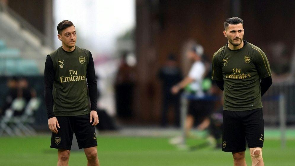 Özil (l.) und Kolasinac wurden im Juli überfallen - Bildquelle: AFPSIDOZAN KOSE