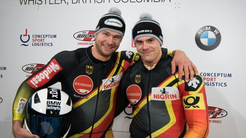Sieg im Teamwettbewerb für Johannes Lochner (l.) - Bildquelle: IBSFIBSFIBSFViesturs Lacis