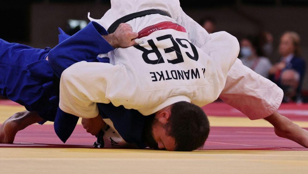 Igor Wandtke gewinnt seinen Kampf im Mixed-Achtelfinale - Bildquelle: AFPSIDJACK GUEZ