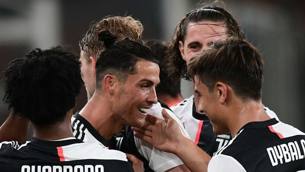 Ronaldo (M.) trug sich in die Torschützenliste ein - Bildquelle: AFPSIDMIGUEL MEDINA