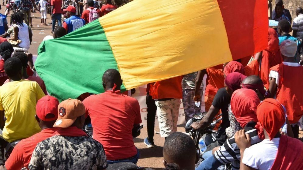 Corona: Guinea bleibt Tokio fern - Bildquelle: AFPSIDCELLOU BINANI