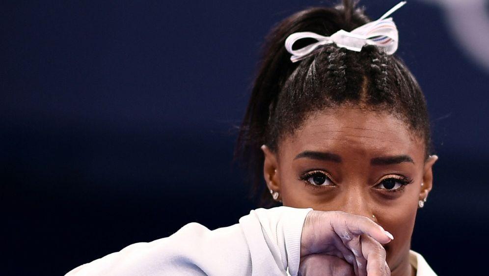 Simone Biles brach den Team-Wettkampf in Tokio ab - Bildquelle: AFPSIDLOIC VENANCE