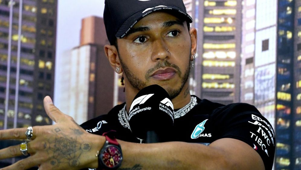 Weltmeister Lewis Hamilton gedenkt Legende Niki Lauda - Bildquelle: AFPSIDWILLIAM WEST