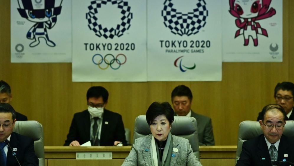Yuriko Koike (M.) will Kostensteigerung entgegenwirken - Bildquelle: AFPSIDCHARLY TRIBALLEAU