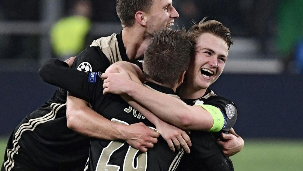 Ajax-Kapitän Matthijs de Ligt (r.) voller Freude - Bildquelle: AFPSIDMARCO BERTORELLO