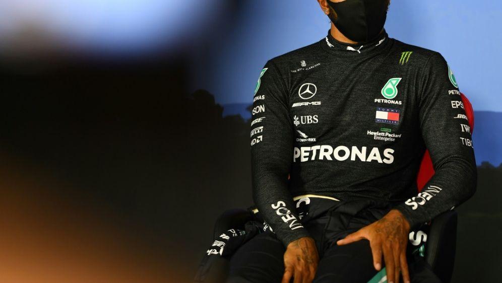 Glück für Weltmeister Hamilton - Keine Rückversetzung - Bildquelle: AFPSIDMario RENZI
