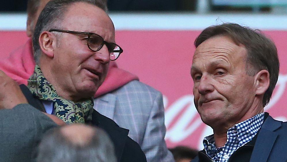 Schwierige Zeiten: Bayern-Boss Karl-Heinz Rummenigge (l.) und BVB-Geschäftsf... - Bildquelle: Getty