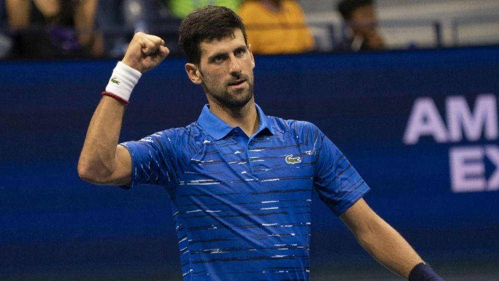 "Erst Kritik, jetzt ""extrem glücklich"": Novak Djokovic - Bildquelle: AFPSIDDON EMMERT"