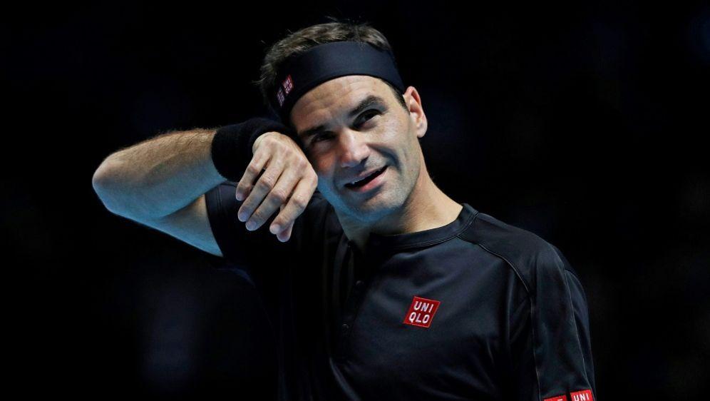 Roger Federer droht bei den ATP-Finals das Aus - Bildquelle: AFPAFPAdrian DENNIS