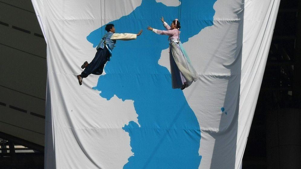 Olympia: Korea könnte unter gemeinsamer Flagge auflaufen - Bildquelle: AFPSIDJUNG YEON-JE