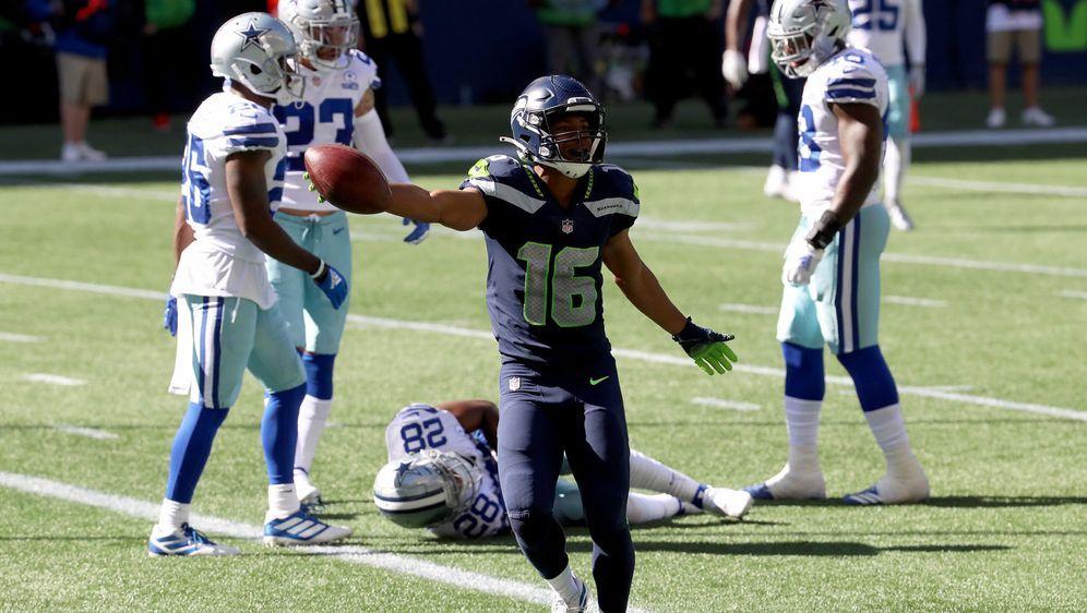 Tyler Lockett gelangen gegen die Cowboys drei Touchdowns in der ersten Halbz... - Bildquelle: 2020 Getty Images