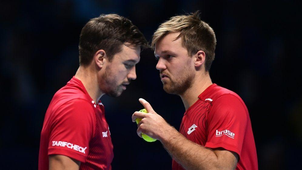 Krawietz (r.) und Mies verlieren ihr Halbfinale - Bildquelle: AFPSIDGLYN KIRK