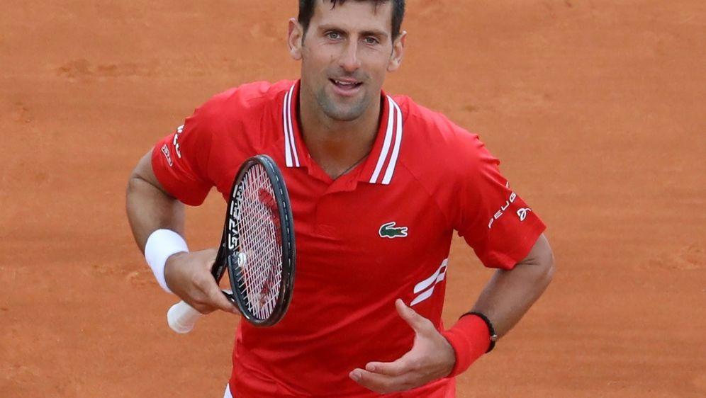 Djokovic setzt sich gegen Jannik Sinner durch - Bildquelle: AFPSIDValery HACHE