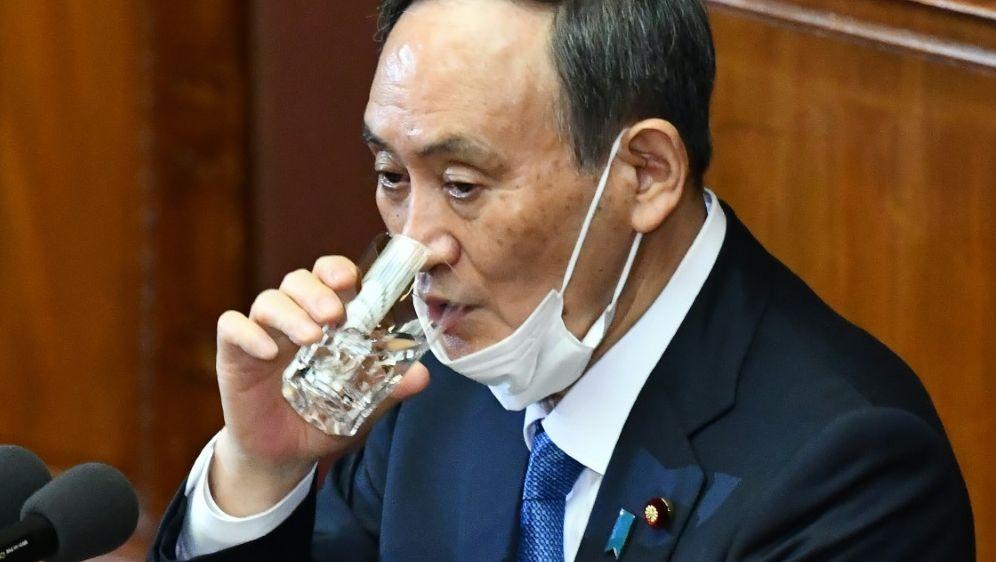 Premier Suga widerspricht Absage-Gerüchten - Bildquelle: AFPSIDKAZUHIRO NOGI